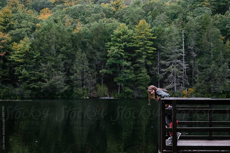 kid by lake by Léa Jones for Stocksy United