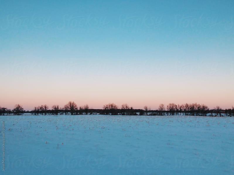 frozen landscape of michigan  by Jesse Morrow for Stocksy United