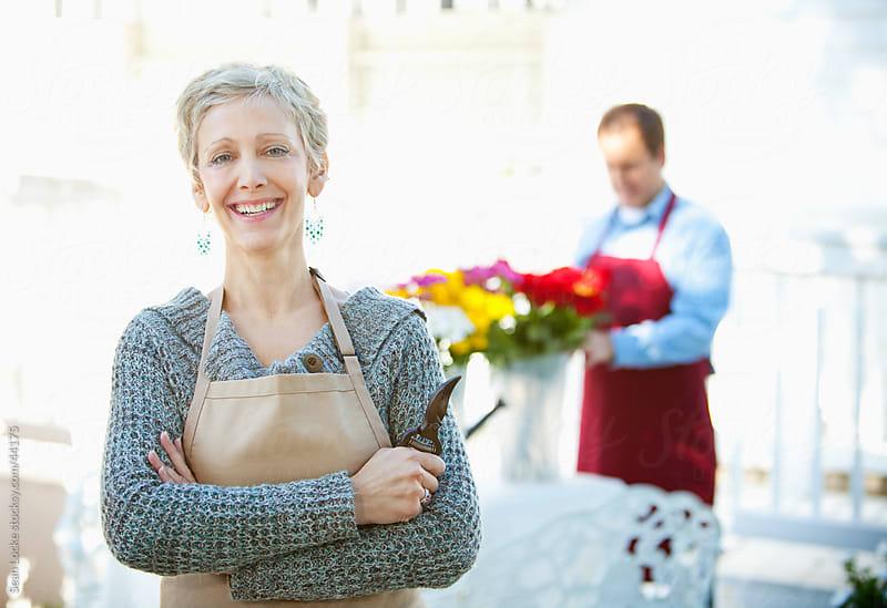 Shop: Cheerful Florist Outside Shop by Sean Locke for Stocksy United