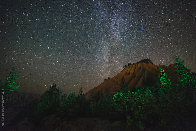 A starry night in an old quarry by Tõnu Tunnel for Stocksy United