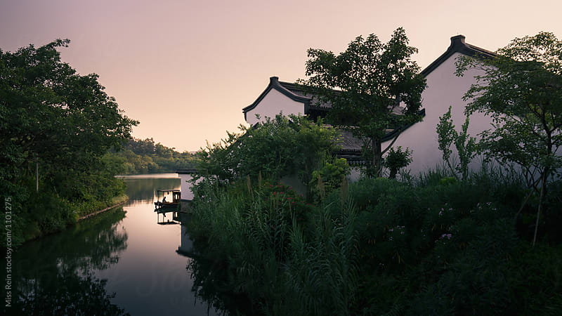 Chinese Garden, with the river and boat by Miss Rein for Stocksy United