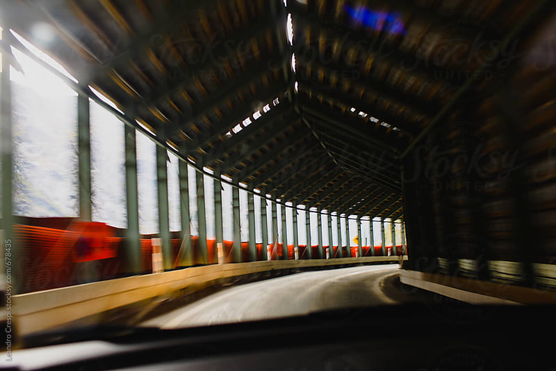 Driving through an empty tunnel very fast by Leandro Crespi for Stocksy United