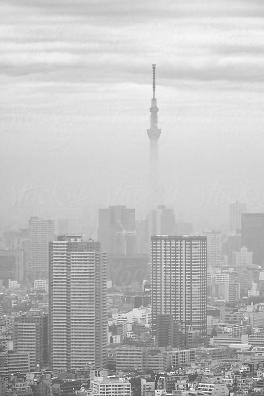 The of Tokyo on a foggy day by Jason Hill for Stocksy United