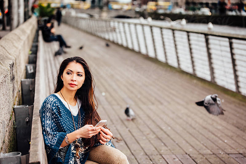 Beautiful Asiatic Girl Using Phone in a City Area by HEX. for Stocksy United