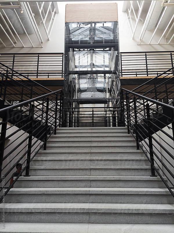 Stairs and elevator by Lyuba Burakova for Stocksy United
