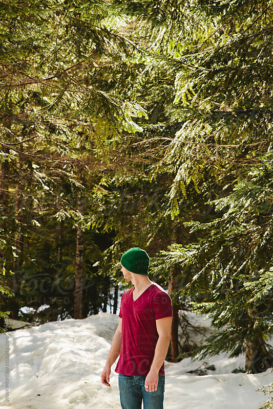 Young man standing in woods by Jesse Morrow for Stocksy United