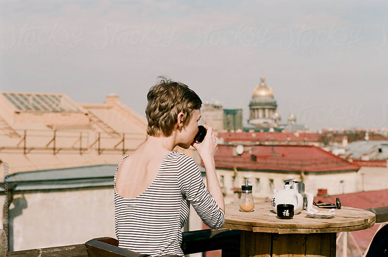 Woman drinking tea outdoors by Liubov Burakova for Stocksy United