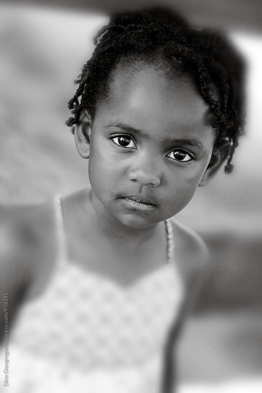 Portrait of African American Little Girl With Serious Expression by Dina Giangregorio for Stocksy United