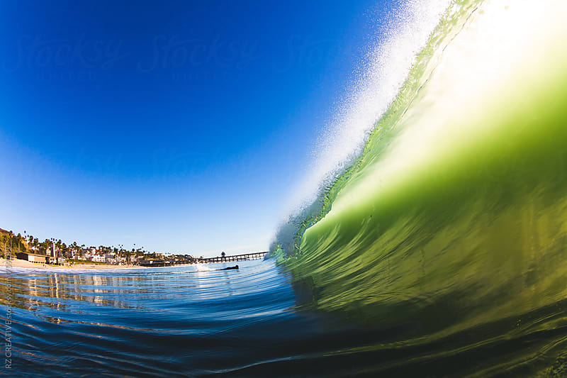 Water shot of a breaking wave on a bright sunny day by Robert Zaleski for Stocksy United