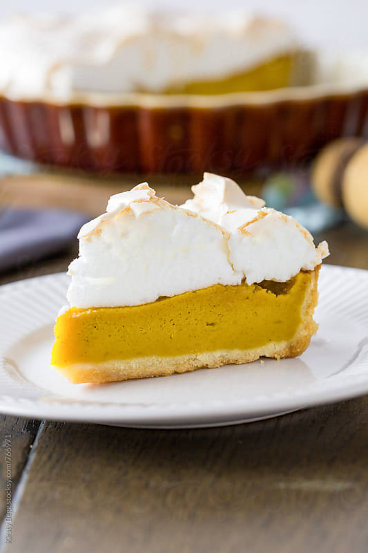 Slice of pumpkin pie with meringue top, vertical close up by Kirsty Begg for Stocksy United