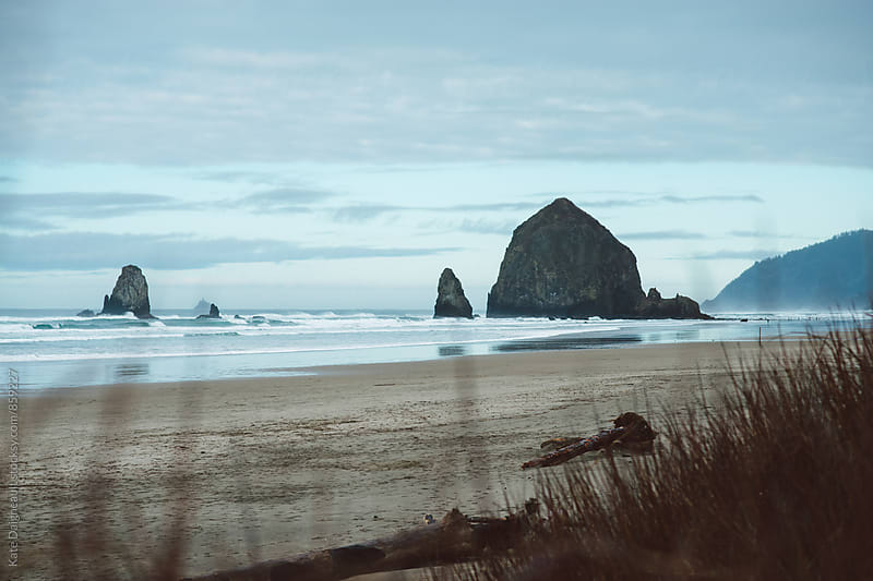 Famous Haystack Rock on an overcast day by Kate Daigneault for Stocksy United