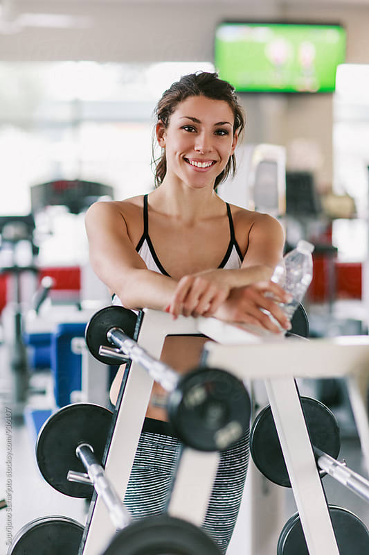 Happy woman working out in the gym  by Suprijono Suharjoto for Stocksy United