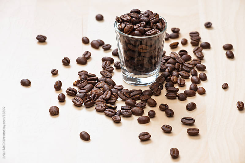 Whole Coffee Beans in Shot Glass by Brian McEntire for Stocksy United