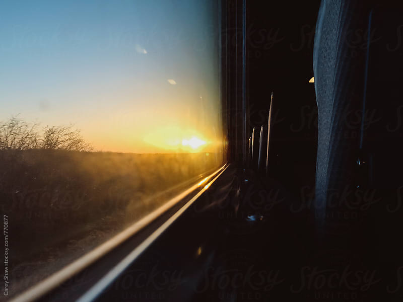 Sunset view from train window by Carey Shaw for Stocksy United
