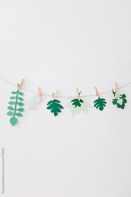 Paper Leaves Hanging on a String by Katarina Radovic for Stocksy United