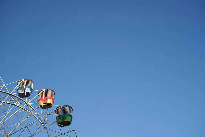 Ferris Wheel and Blue Sky by Adrian Young for Stocksy United