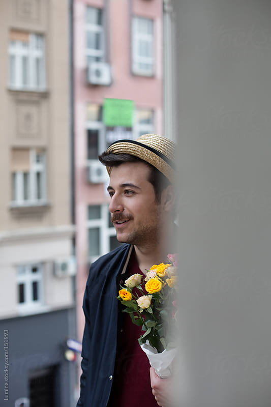 Man Holding a Bouquet by Lumina for Stocksy United