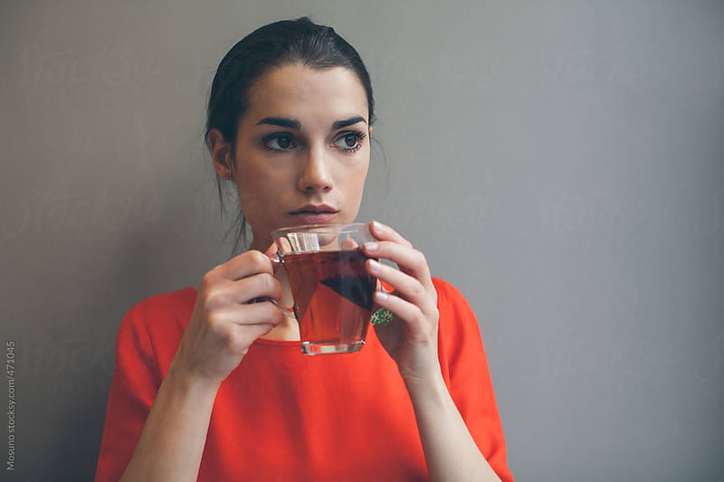 Young Brunette Holding a Cup of Tea by Mosuno for Stocksy United