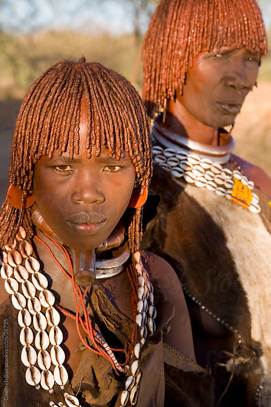Portrait of two Hamer women with goscha (ochre and resin hair tresses), Hamer Tribe, Lower Omo Valley, southern area, Ethiopia, Africa by Gavin Hellier for Stocksy United