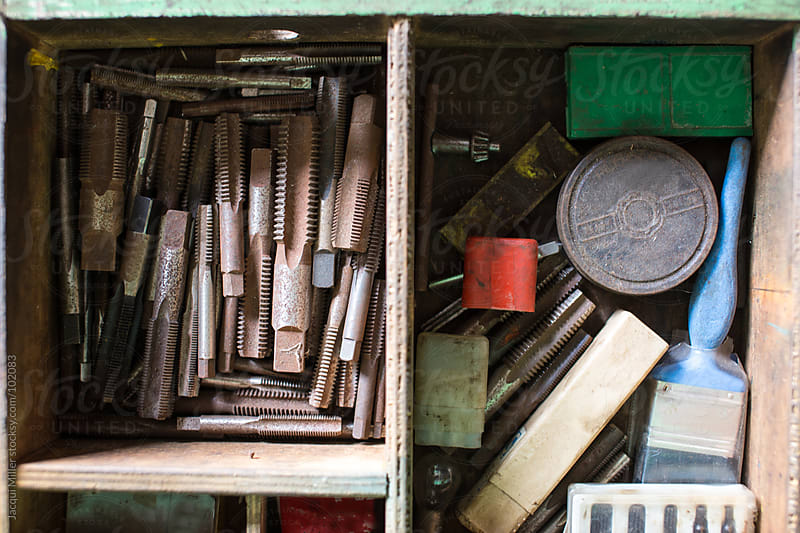 A drawer full of old tools in a toolshed by Jacqui Miller for Stocksy United