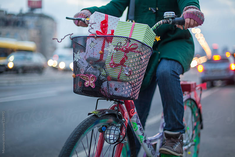 Woman on a Bicycle with Christmas Gifts in a Basket by Mosuno for Stocksy United