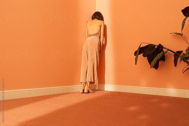 woman wearing culottes in a room by Ulaş and Merve for Stocksy United