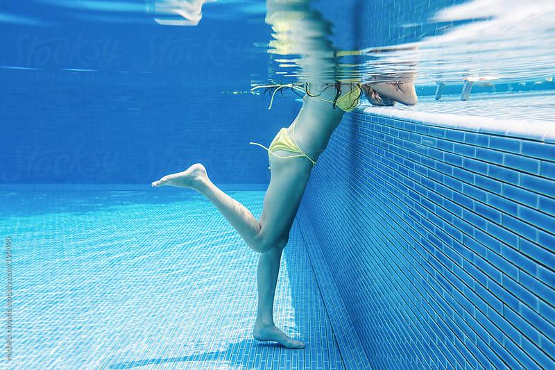 Woman's legs, underwater view. by michela ravasio for Stocksy United