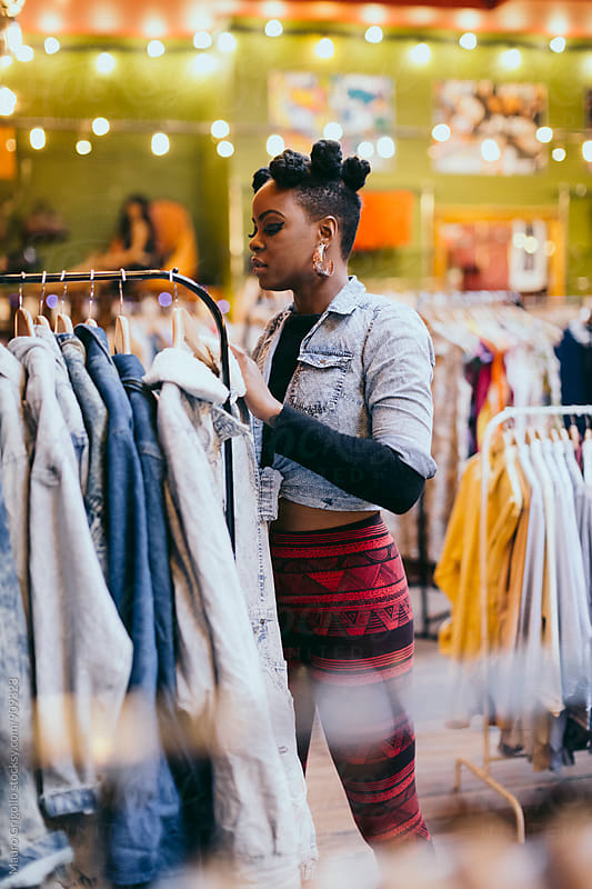 Black woman during Shopping by Mauro Grigollo for Stocksy United
