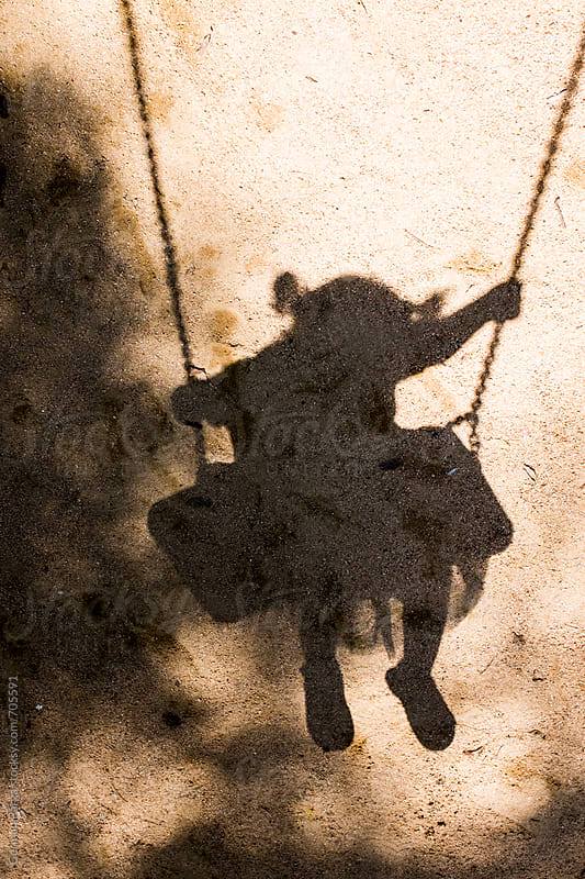 Girl swinging shadow by German Parga for Stocksy United