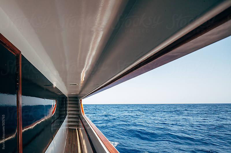 Cruise ship deck with ladder and sea view by Ilya for Stocksy United