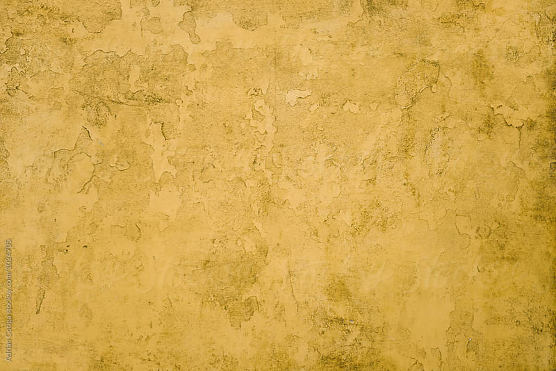 Yellow wall texture by Adrian Cotiga for Stocksy United