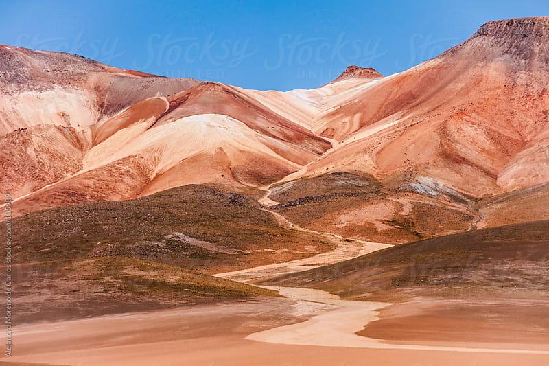Red sand mountain in desert landscape, Bolivia by Alejandro Moreno de Carlos for Stocksy United