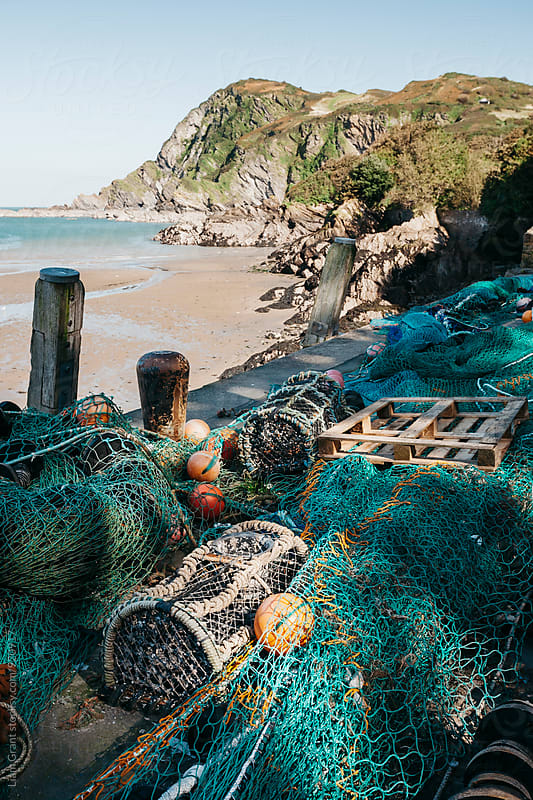 Fishing nets and lobster pots in the harbour at Ilfracombe. Devon, UK. by Liam Grant for Stocksy United