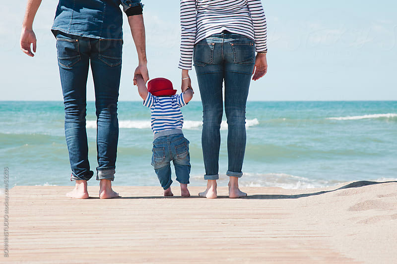 Family walking on the beach with baby. by BONNINSTUDIO for Stocksy United
