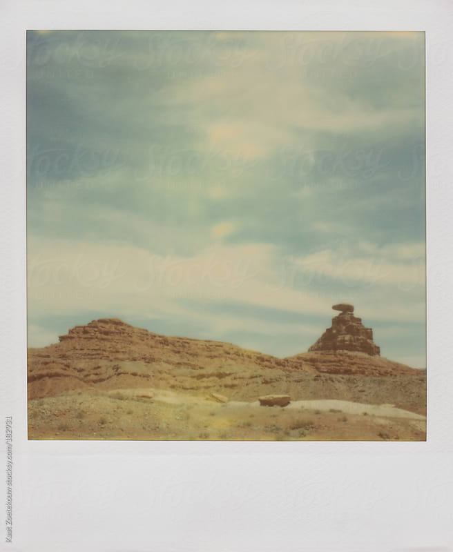 Polaroid image of the Mexican Hat rock formation near Monument Valley by Kaat Zoetekouw for Stocksy United