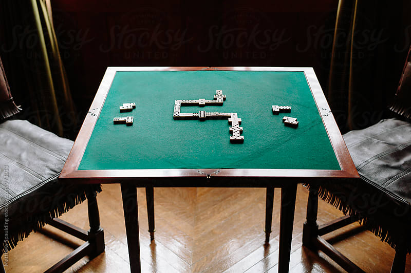 Dominoes strategy game on felt table by Matthew Spaulding for Stocksy United
