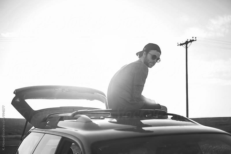 Man on Car by K. Howard for Stocksy United