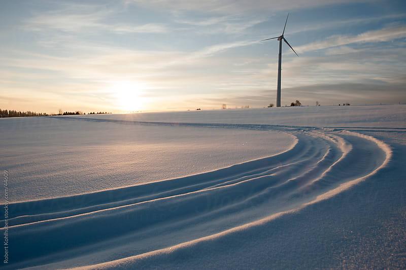 Windmill in winter landscape by Robert Kohlhuber for Stocksy United