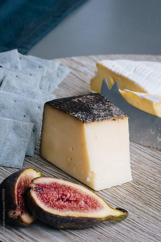 cheese and crackers, with figs by Gillian Vann for Stocksy United