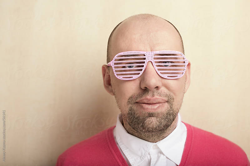 nerd with pink party glasses by Alexey Kuzma for Stocksy United