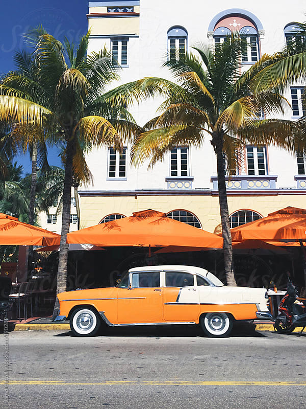 Classic Car outside Art Deco Hotel in South Beach, Miami  by Jared Harrell for Stocksy United