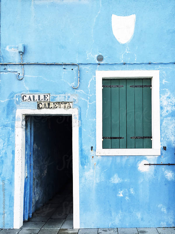 Door entrance in blue house in Burano, Venice by Kirstin Mckee for Stocksy United