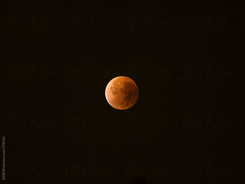 Blood Moon, Super Moon  lunar eclipse, red moon eclipse by DV8OR for Stocksy United