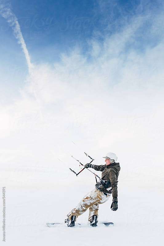 Portrait of a young man riding snow kite  by Jovana Milanko for Stocksy United