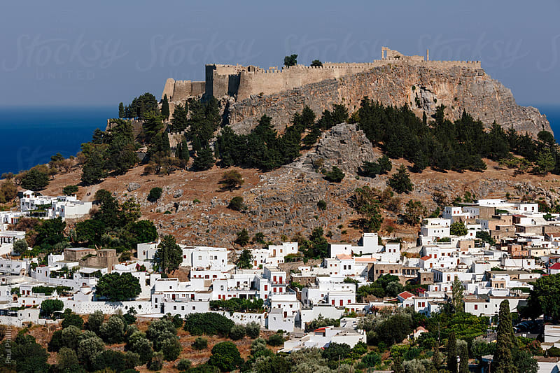 Lindos town and acropolis, Rhodes, Greece by Paul Phillips for Stocksy United