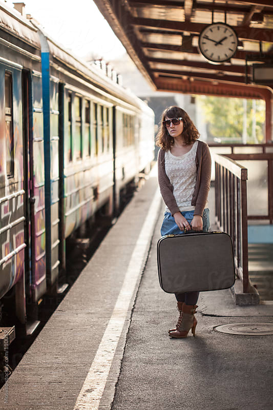 Woman With Suitcase at the Train Station by Mosuno for Stocksy United