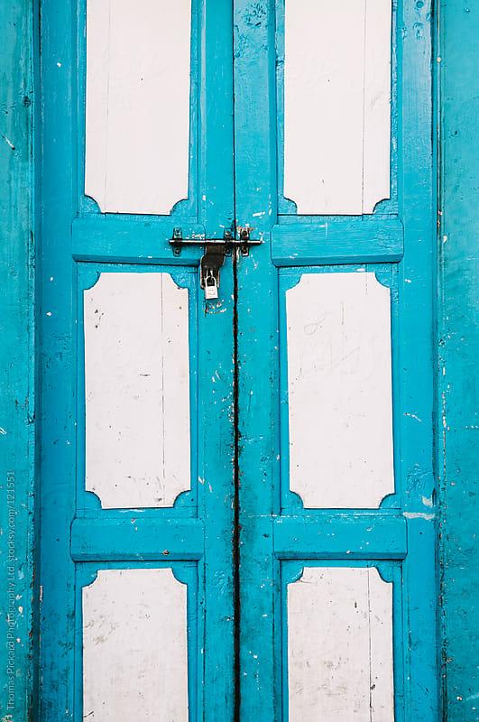 Locked blue door, Lukla Valley, Everest Region, Sagarmatha National Park, Nepal. by Thomas Pickard Photography Ltd. for Stocksy United