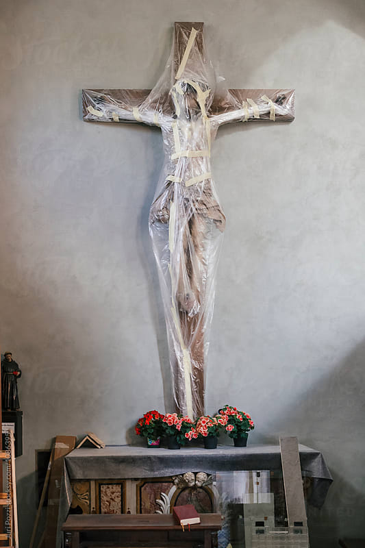 Jesus statue wrapped for restoration by Juri Pozzi for Stocksy United