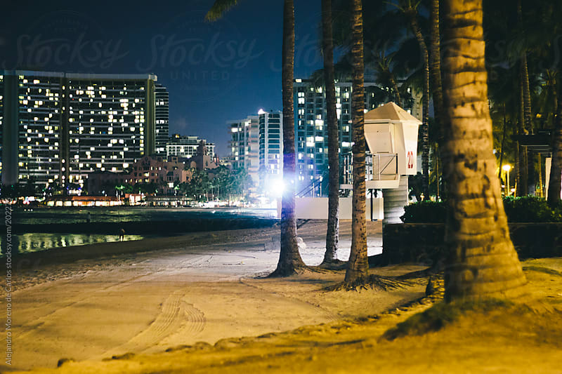 Beach at night - Waikiki, Honolulu, Hawaii by Alejandro Moreno de Carlos for Stocksy United