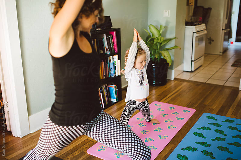 Mommy and me yoga time. by Kate Daigneault for Stocksy United